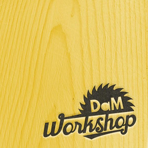 Dam Workshop Logo on Yellow Wood